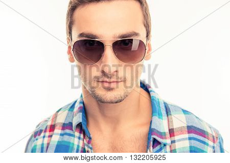 Handsome calm man with glasses  on a white background