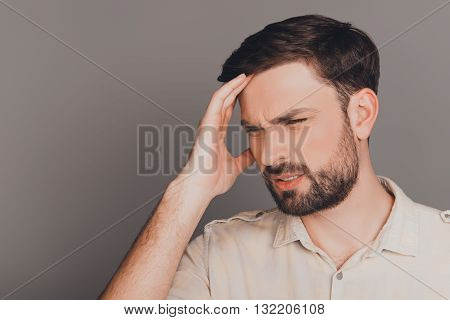 Young Guy With Big Problems Having Strong Headache