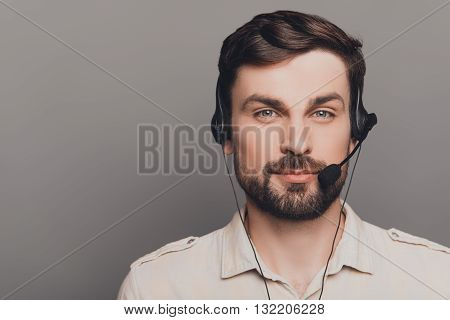 Portrait Of Handsome Smiling Man In Head-phones In Call Center