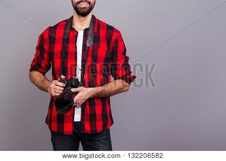 Close Up Photo Of Man In Red Checkered Shirt Holding Camera