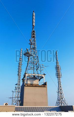 antenna repeater sattelite 3g 4g tower on blue sky