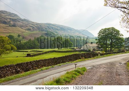 Road  through the countryside.  A typical Lake District scene. Lake District National Park, Cumbria, England, UK.