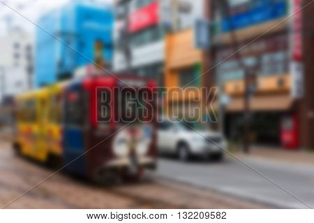 Hakodate Tram By Blurred Abstract Image