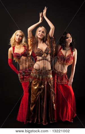 Three young girls dance in arabian costume