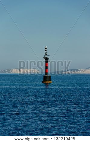 Photo of a lighthouse on the sea.