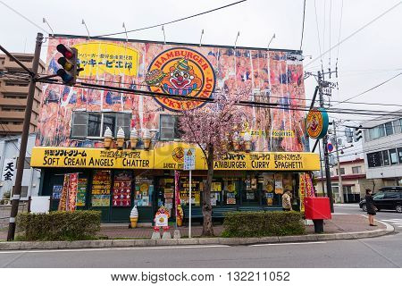 HAKODATE JAPAN - APRIL 22 2016: Lucky Pierrot hamburger shop the famous local hamburger shop located in Hakodate area with cherry blossom.