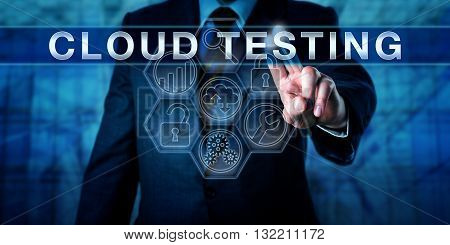 Manager is pushing CLOUD TESTING on an interactive virtual touch screen interface. Business metaphor and information technology concept for successful tests of software via cloud infrastructure.