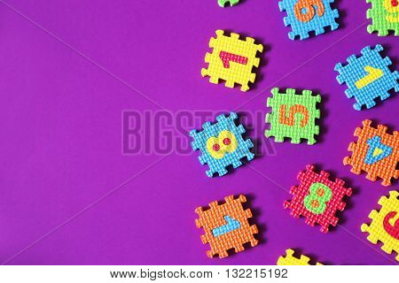 Colorful kids toys on purple background