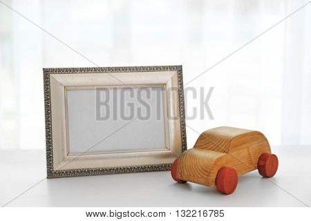 Child toy with frame on white wooden table