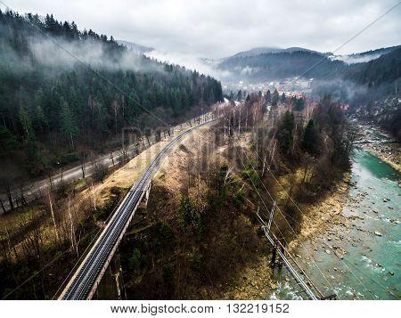 misty view on railroad bridge in Carpathian mountains, Ukraine