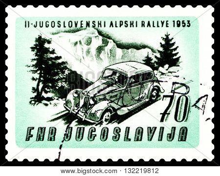 STAVROPOL RUSSIA - MARCH 30 2016: a stamp printed in Jugoslavia shows rally car. Auto near Mt. Triglav cirka 1953