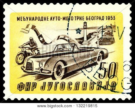 STAVROPOL RUSSIA - MARCH 30 2016: a stamp printed in Jugoslavia shows rally car. Racers leaving Belgrade cirka 1953