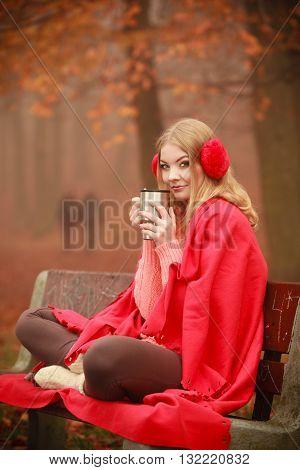 Young Woman Holding Thermal Mug.