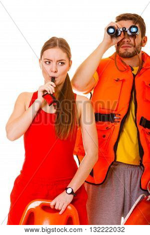 Lifeguards In Life Vest With Ring Buoy Whistling.