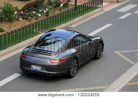 Monte-Carlo Monaco - May 18 2016: Luxury Black Porsche 911 Carrera S on Avenue Princesse Grace in Monte-Carlo Monaco in the south of France