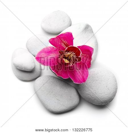 White spa stones and red orchid isolated on white