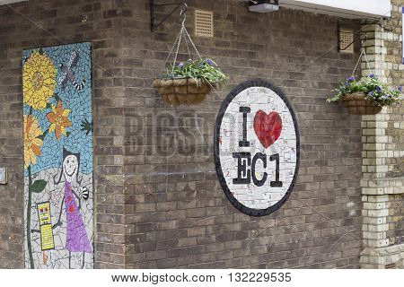 London England - May 19 2016: A street mosaic created by the students of Prior Western Primary School working with artists Carrie Reichardt Karen Wydler and Sian Smith. Supported by Islington Council Whitecross Street Party Whitecross Street Community Cen