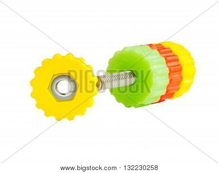 Plastic nut screw produced by 3d printing with incorporated iron nut. Bolt with yellow red and green 3d printed nut screws. Soft focus. Focus on first yellow nut screw. Isolated in white. Cutout macro. Thermoplastic filament for 3d printer used.