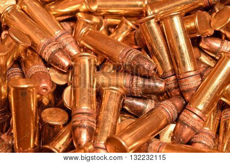 Close up shot of a pile of old .22 cal rimfire ammunition