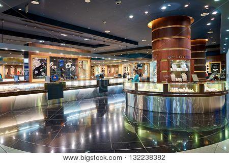 DUBAI, UAE - APRIL 09, 2016: inside of Dubai International Airport. Dubai International Airport is the primary airport serving Dubai, United Arab Emirates