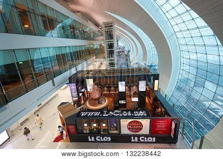 DUBAI, UAE - MARCH 09, 2016: inside of Dubai International Airport. Dubai International Airport is the primary airport serving Dubai, United Arab Emirates