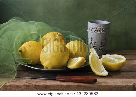 Still life with lemons and green gauze