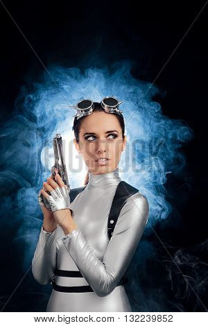 Woman in Silver Space Costume Holding Pistol Gun