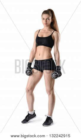 Cutout fitness model showing torso stands looking directly at the camera. Studio portrait. Healthy lifestyle. Happiness. Fitness and sport. Power of body. Sportswear for training.
