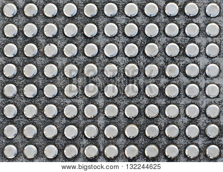 Studs tactile paving textured surface for blind or visually impaired people at a pedestrian crossing
