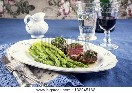 Medaillons with Green Asparagus on Plate