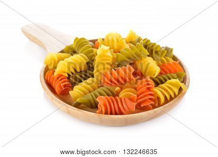 Large vegeroni Rotini spirals pasta in wooden plate on white background