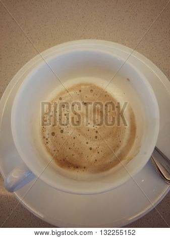 Top view of drunk cappuccino coffee vintage effect