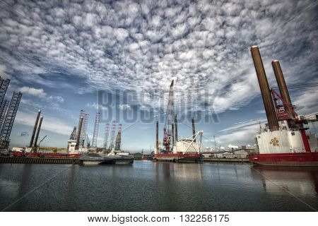 ESBJERG - MAY 28: Esbjerg harbor with windmill equipment and boats. Offshore Construction Jack Up and Offshore wind operations and maintenance. May 28 2016 Esbjerg Denmark.