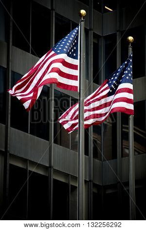 American flags waving in front of a building