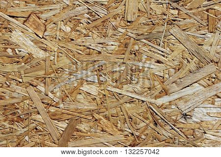 Close up view of particleboard panel. Suitable for an abstract background.