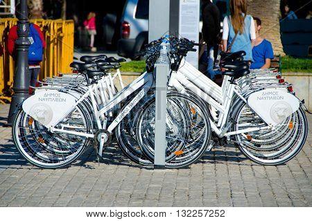 NAFPLIO GREECE - MAY 31 2016: Rent a bike at the municipal quay in NafplioArgolis . Bicycles as the most environmentallyfriendlytransport