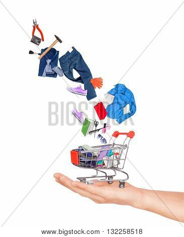 purchases fall into the shopping cart on white background
