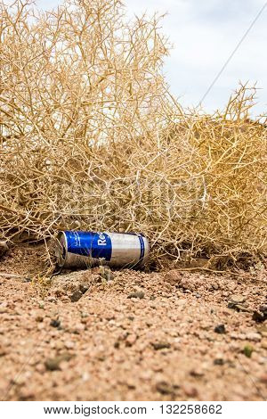 Sharm El Sheikh Egypt - May 07 2014: Empty cans of Red Bull in the dry desert
