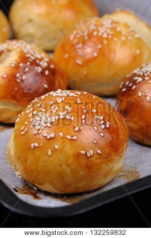 Buns with sesame in a pan just out of the oven