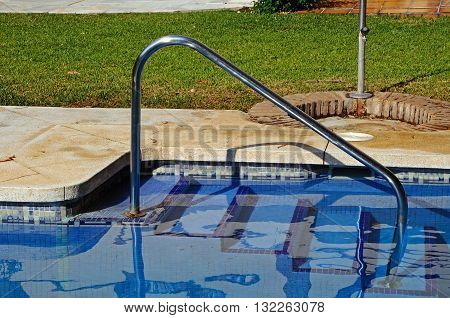 Swimming pool handrail and steps Costa del Sol Andalucia Spain Western Europe.