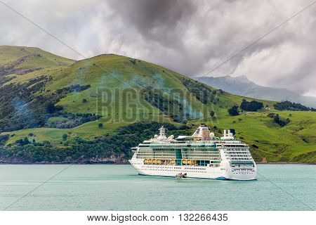 Akaroa New Zealand - November 17 2014: The Radiance of the Seas cruiseship at anchor in Akaroa harbour Canterbury region of the South Island of New Zealand.