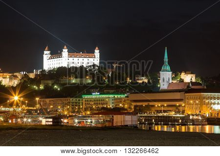 Bratislava, Slovakia - May 29, 2016 River Danube lining the old city of Bratislava Slovakia. Night view on the hill with the castle and historical cathedral of St. Martin.