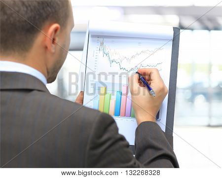Stock market graphs monitoring. Business advizer analizing financial statistics