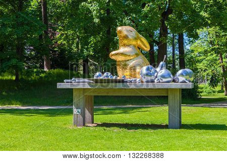 Riga Latvia - 25-May-2016: Art still life of artists Brigita Zelca-Aispure and Sandis Aispurs - sculpture of hare and fruits in Botanical Garden. Riga Latvia