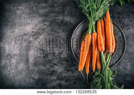 Carrot. Fresh Carrots bunch. Baby carrots. Raw fresh organic orange carrots. Healthy vegan vegetable food. Fresh Vegetable.