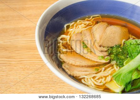 close-up of stewed duck with egg noodles soup