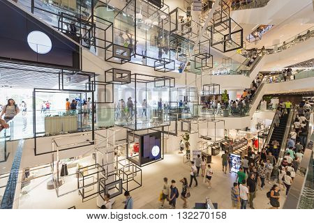 Bangkok Thailand - May 29 2016: Inside new renovated shopping center called 'Siam Discovery' in Bangkok. There was crowded walking around. This place decorated in modern style.