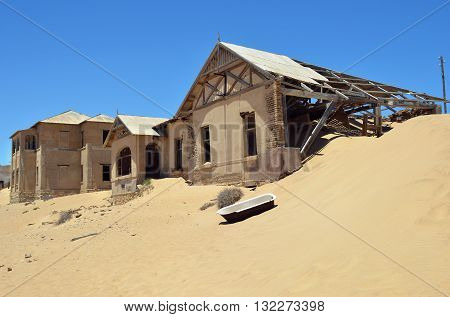 The abandoned ghost diamond town of Kolmanskop in Namibia which is slowly being swallowed by the desert