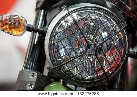 Color image of a classic motorcycle headlight.