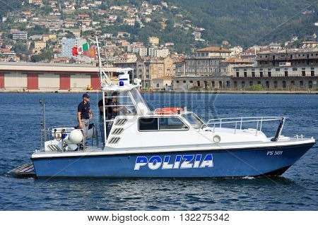 Trieste Italy - September 27 2009: A marine police patrol boat carrying three officers patrolling the waters off the port.